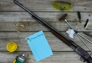 Rifle with cleaning tools and safety goggles